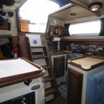 Galley and Navigation Sation, the companionway stairs open up to reveal the entire engine room. This makes checking up on the engine a breeze! Open the stairs and you have instant visual access to nearly all the ships vital organs.