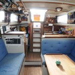 "Looking Aft, notice that in the saloon there is nearly 6'10"" head room and 6'4"" in the galley!"