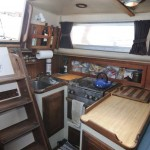 Galley,Stainless stove,fridge opens from the top just fwd. of the stove and is huge!