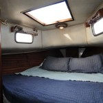 V-Berth, there is a standing closet to stbd and below the bed is two drawers and ample storage! The large hatch gives great ventilation to the entire boat.