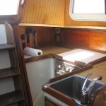 Galley on Port.. look at wood paneling in corner and white behind the stairs.