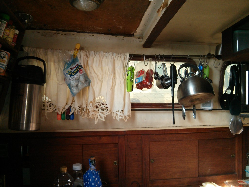 Both the pump pot with water in it and the kettle as well as other stuff pictured here hangs from bronze curtain rods.
