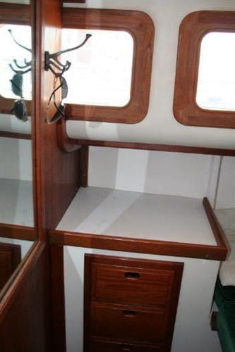 Forward in the aft cabin. You can see mirror on bulkhead and vanity outboard. Bulkhead hits forward starboard window the same place the chart table ends on standard layout.